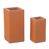 "A Pair of Block ""Terra-Cotta"" Planters"