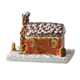 Gingerbread Cabin in Snowy Yard