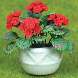 Red Geraniums in Wall Planter