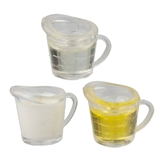Three Filled Measuring Cups