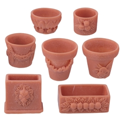 Seven Assorted Fancy Planters